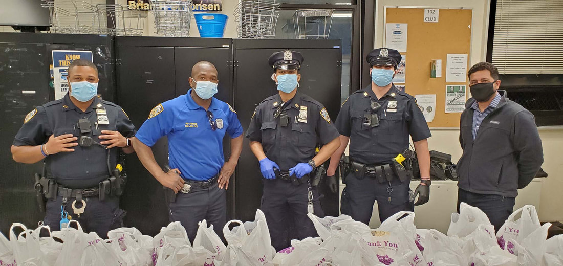 five police officers wearing face masks inside an office